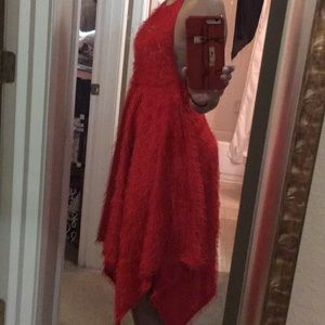 Red backless dress with adjustable neck tie.